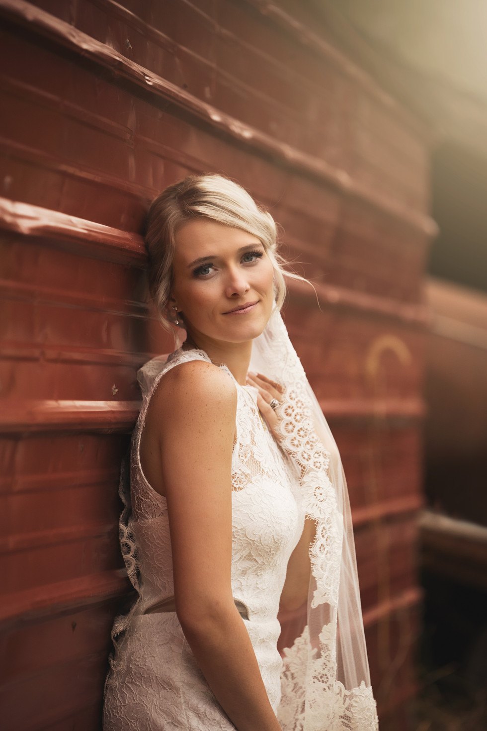 Bride against a red barn