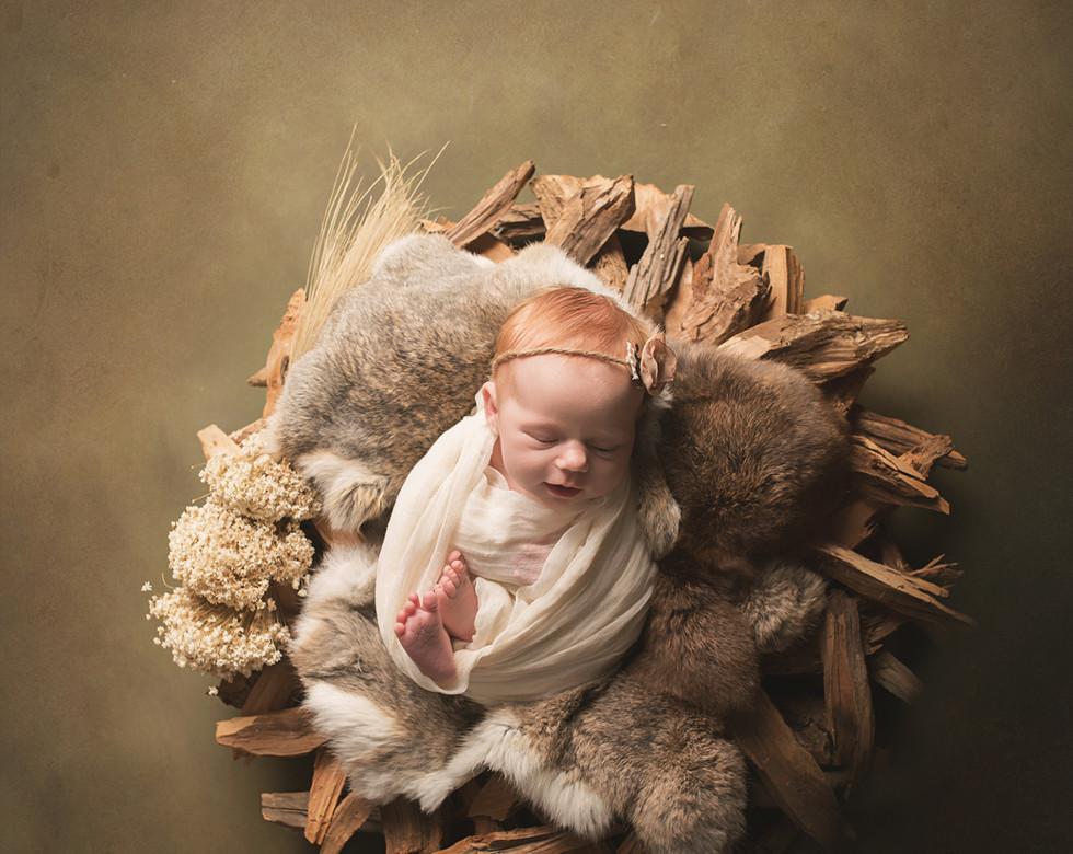 newborn redhead in wood wreath.jpg