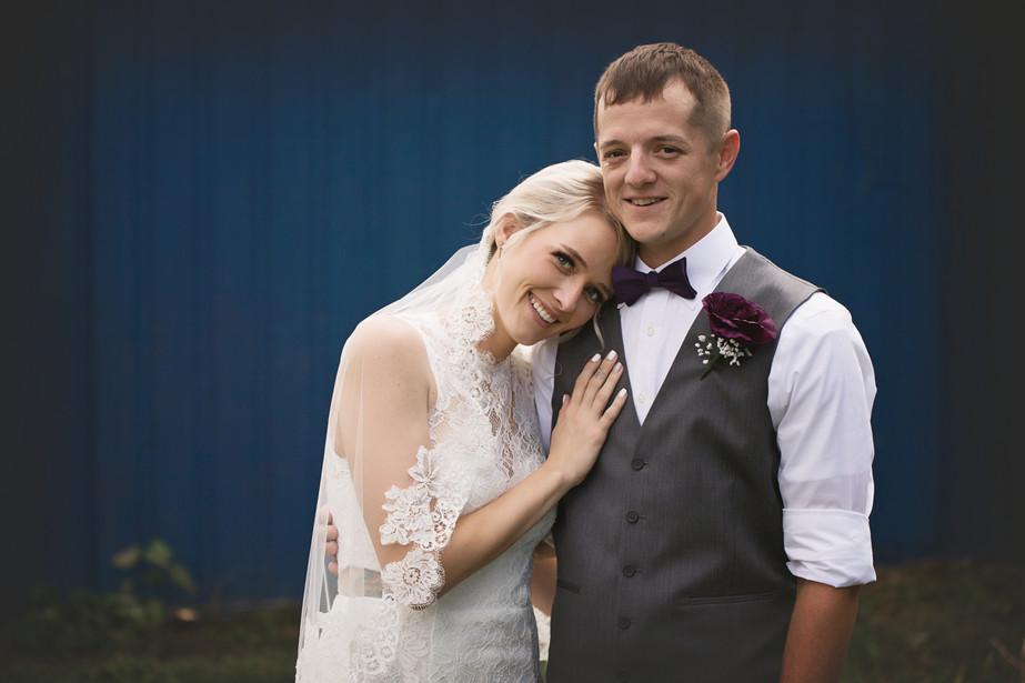 Newlyweds Bride and Groom hugging