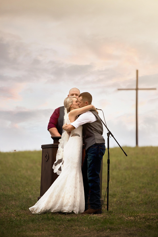 wedding couple newlyweds first kiss