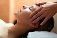 Beautiful woman having an head massage.j