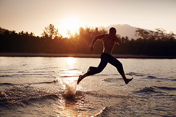 Man running on the sea at sunrise  .jpg