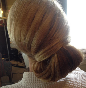 A wedding updo beautiful from every angle.