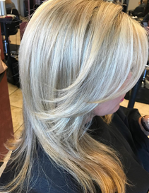 Bright and fresh blonde highlights with freshly cut hair.