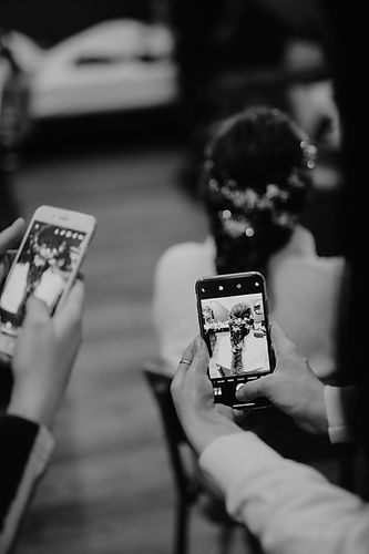 black and white wedding hair people taking picture with phone