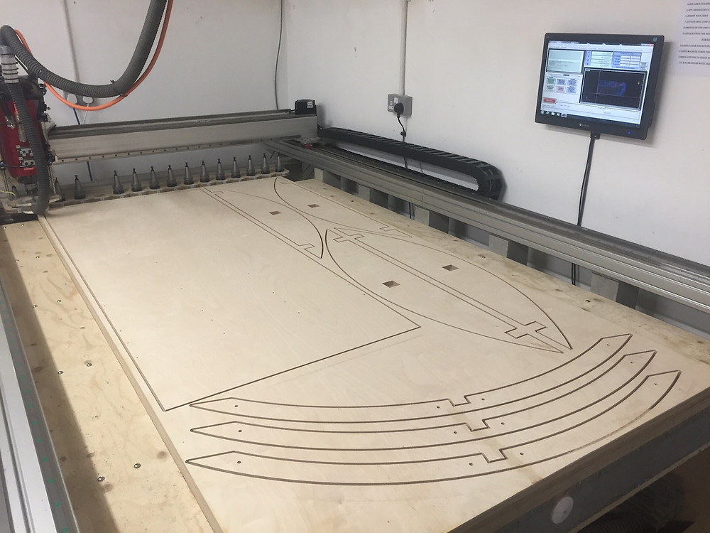 CNC cutting of a curved base kitchen unit