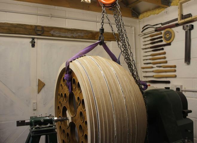 Stepped CNC fabricated raised onto lathe