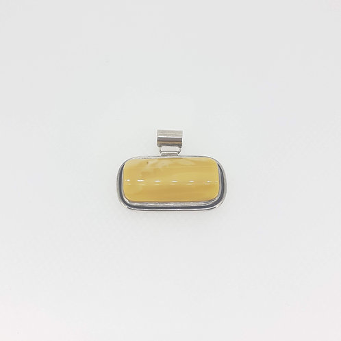 Amber set in silver pendant