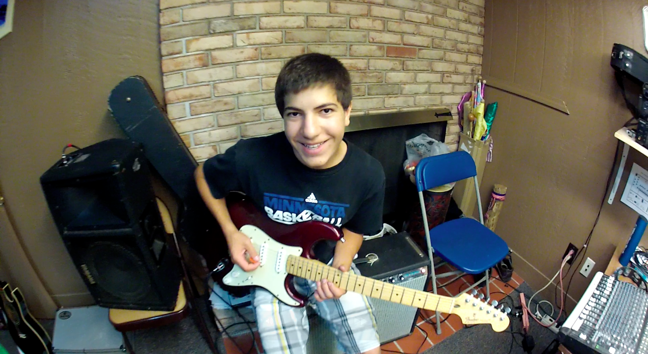 anthony on guitar.png