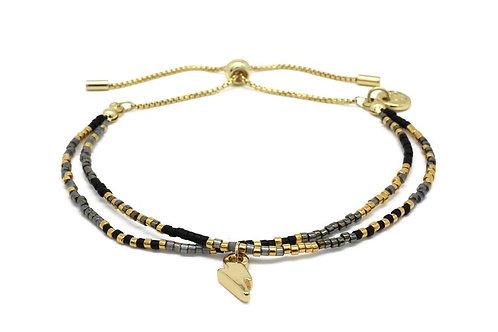 Black Gemstone Bracelet with Gold Lightening Bolt
