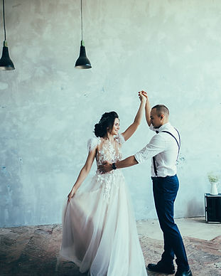 Cute wedding couple dancing at loft inte