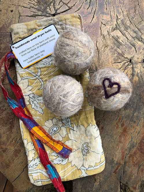 Hand crafted wool dryer balls with cotton kantha bags
