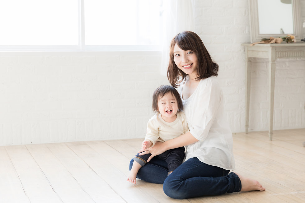 portrait of asian mother and baby relaxi