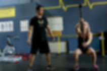 Intuitive Roots providing Solo Personal Training instruction with an Onnit steel mace.
