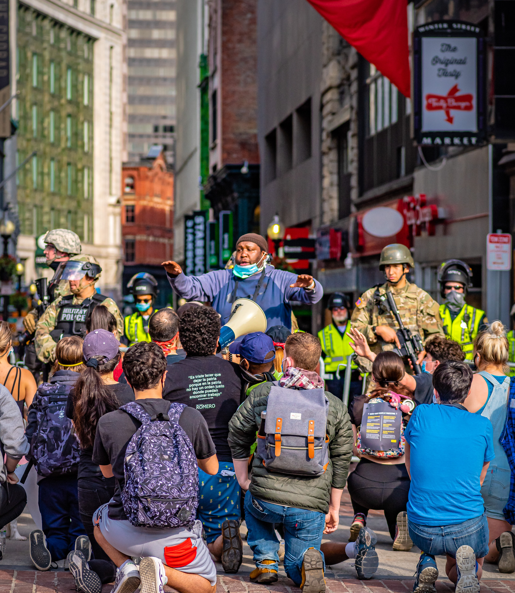 This was an appeal to the Military police to kneel along with the protesters. They did not. One of the MP's was a photographer. Shooting for military publications, or for...?