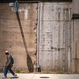 Pedestrian wearing a mask in an otherwise abandoned city of Lynn.