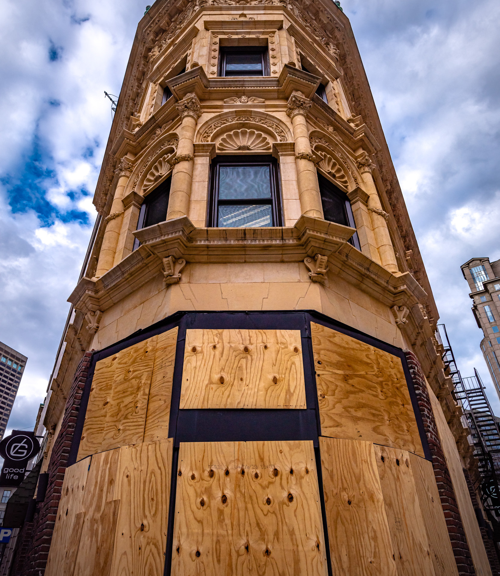 Boarded up - to protect from looting, I suppose.