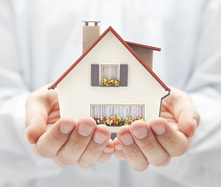 bigstock-Small-toy-house-in-hands-175447