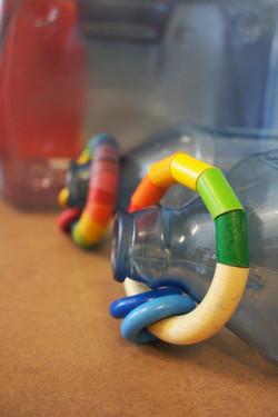 Wooden rings on bottle necks
