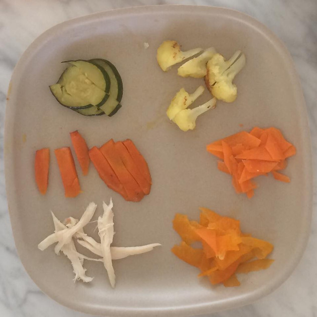 The rest of the meals in this gallery are for a 5 year old, so here is an example of what an early meal would look like. Clockwise: cauliflower, shredded carrot, shredded bell pepper, chicken, cooked carrot, zucchini. All easy to prepare and identify. I don't get any fancier than this until the kids are older and cooking with me.