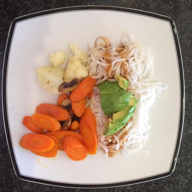 Cauliflower, carrot, mushroom, rice pasta with soy sauce and avocado.
