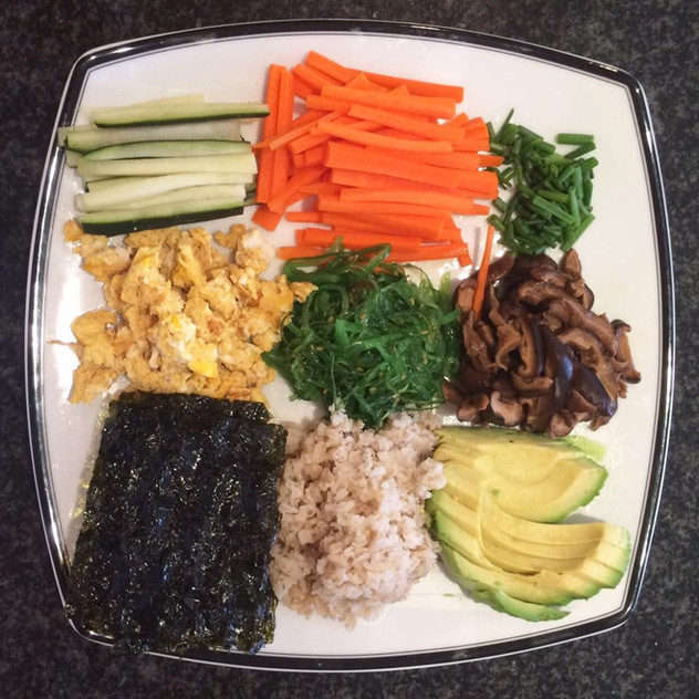 Deconstructed sushi, another favorite! This is the shared meal platter. At the table we serve ourselves from here. Z loves that he gets to choose EXACTLY what goes into each of his hand rolls (well, more like scooped rolls)!  Sea snack, brown rice, avocado, carrot, cucumber, green onion, scrambled egg, wakame salad (bought).  Shiitake mushrooms for sushi Slice Boil with water, soy sauce, a bit of vinegar (Authentic but less kid friendly additions: a ton of sugar, some sake). Boil on low for as l