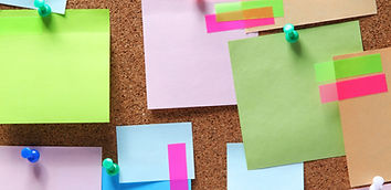 Image of colorful sticky notes on cork b