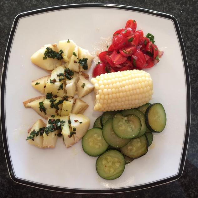 Potatoes, mint, fenugreek seeds, vinegar, cayenne  Zucchini, Corn  Parsley Tomato Salad Parsley, tomato, red onion, olive oil, rice vinegar