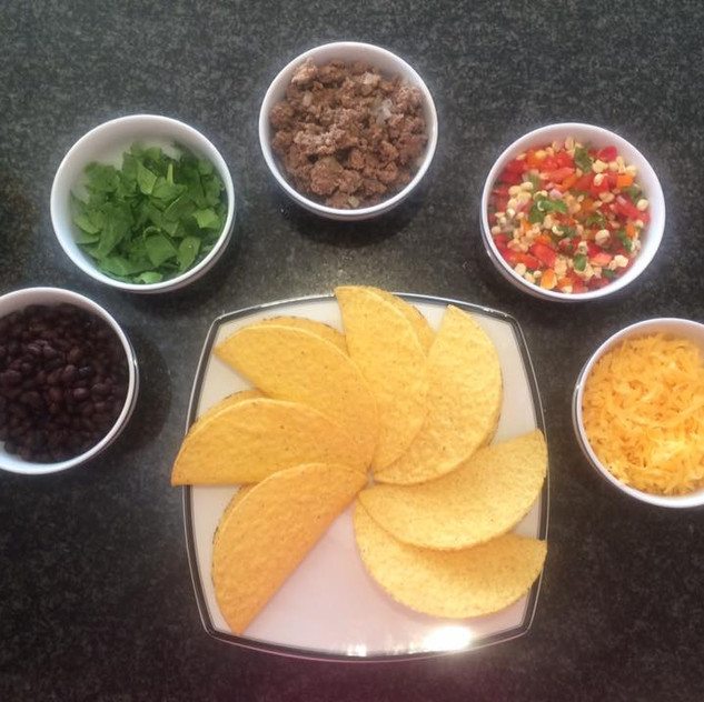 Tacos!!! So popular. Kids really love to choose what goes into their food, and tacos are a great way to do that.  Black beans, cilantro, ground beef, tomato/corn salsa mix, cheese