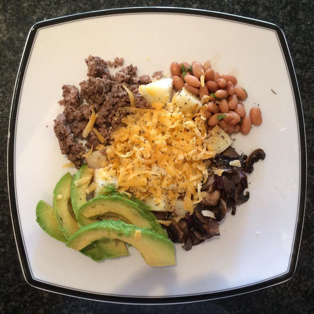 Ground beef, cheese, avocado, mushrooms and onions, pinto beans with parsley