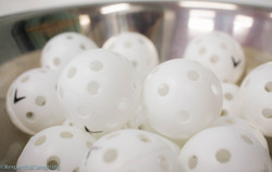 Wiffle balls in stainless steel bowl