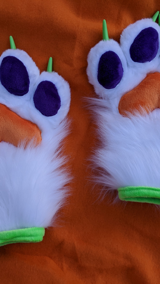 White purple orange and green paws