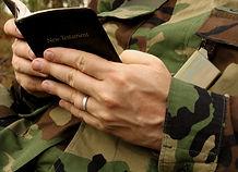 american soldier's hands in uniform read
