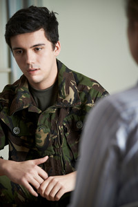 Soldier Suffering With Stress Talking To