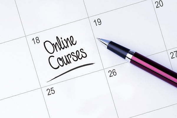 The words Online Courses on a calendar planner to remind you an important appointment with