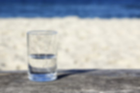 Glass of water which is half-full stands