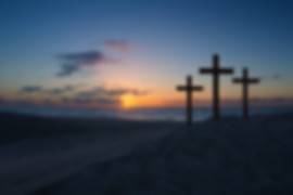Three crosses on a sand dune next to the