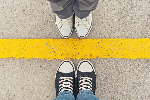 Top View of Sneakers from above, Male and female feet in sneakers, standing at dividing frontier lin