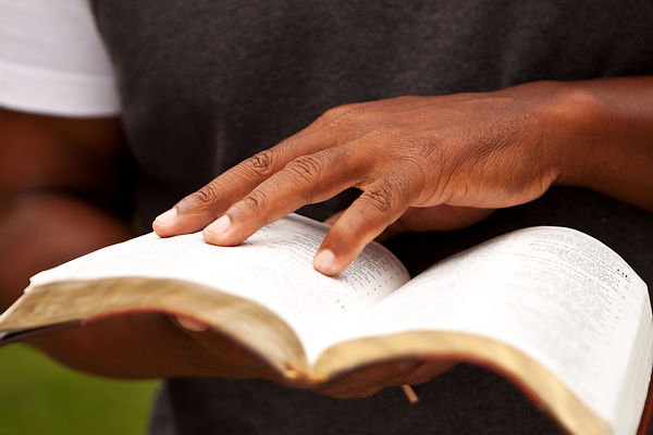 Close up of a man reading the Bible..jpg