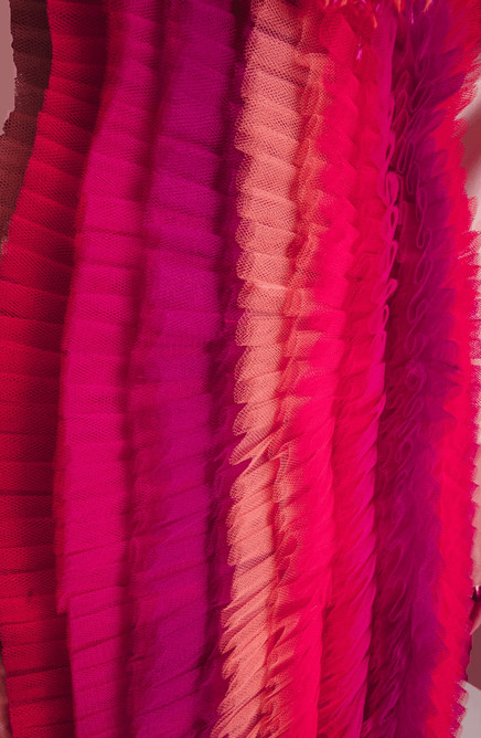Detailshot full of tulle craftmanship resembling daring, fearless, crazy, psychotic, colorful and freaky.