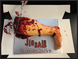 The cutting of the JIGSAW Severed Leg Cake