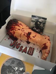 JIGSAW Movie DVD & Blu-Ray with the Severed Leg Cake