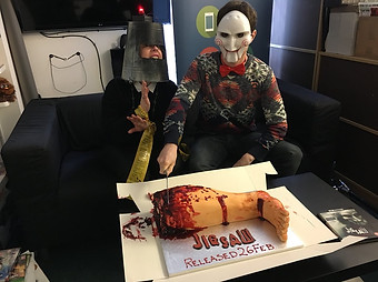 Total Film staff having fun with the JIGSAW Severed Leg Cake
