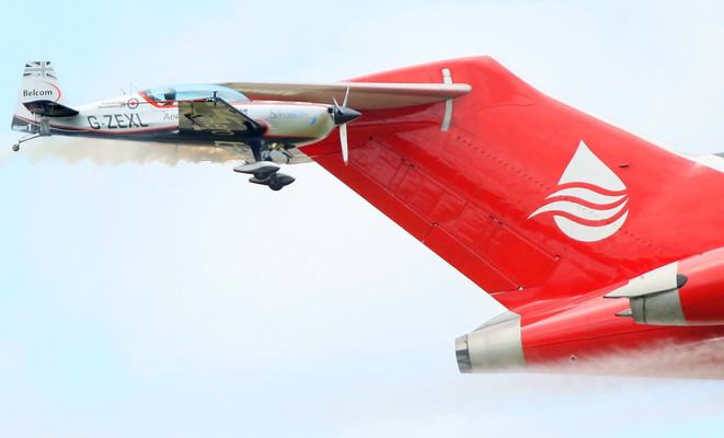 Formation Boeing 727 and aerobatic planes