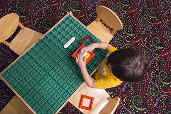 ASD boy playing with blocks