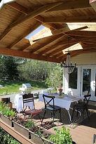 Deck designs, porch covers, rockeries, custom railings.