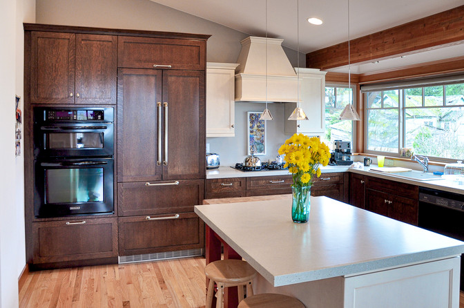 When working with wood floors and wood cabinetry I like to create contrast without having the wood grains compete for attention or bore the client.