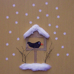 cozy snowy birdhouse.png