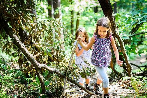 Children - identical twins girls are hik