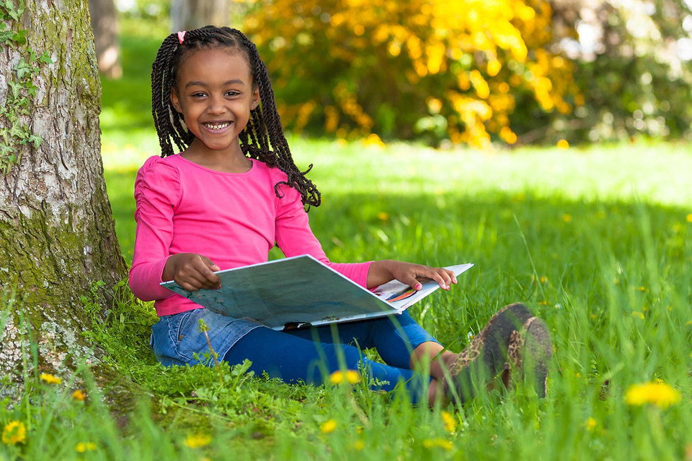 Outdoor portrait of a cute young black l